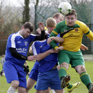 Rathnew's Mark Doyle gets his head to the ball ahead of Peter Farrell and Naoirse Treacy of Ashford Rovers