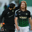 Hugh Douglas of Bray Wanderers leaves the field after picking an a blood injury against Dundalk
