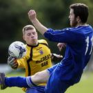Carnew goalkeeper Paddy Adair reaches the ball ahead of Aughrim's Adam Stokley. Picture: Garry O'Neill
