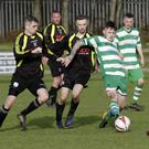 Shane Walker of Arklow Celtic is surrounded by Arklow United trio Karl Kirwan, Jonny Quinn and David O'Neill