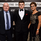 Dáire O'Connor with his parents Eíbhlin and Pat. Photo by Seb Daly/Sportsfile