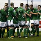 Ronan Coughlan is congratuled by his Bray Wanderers team-mates after scoring the opening goal.