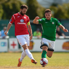 Kyle McFadden of Sligo Rovers closes in on Ger Pender of Bray Wanderers.