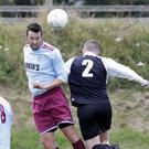 Patrick Woods of St Anthony's and Dean Taylor of Newtown United battle for possession