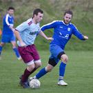 Declan Roper of St Anthony's is tracked by Roundwood's Rob Byrne