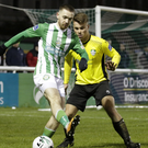 Dylan McGlade of Bray Wanderers is tracked by Vilius Labutis of Cabinteely