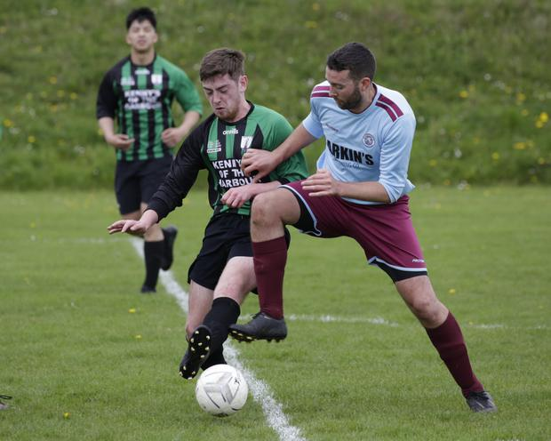Conor Blaney of Arklow United 'A' and Patrick Woods of St Anthony's battle for possession