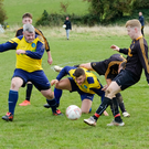 Glencormac's Paul Devlin and Martin Sustovious against Carnew's Conal McCrae