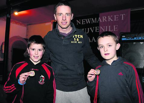 Left to right: Jack O'Connor, Newmarket, Cork Goal Keeper Anthony Nash and Michael Lane Newmarket. Photo: Eileen Feehan