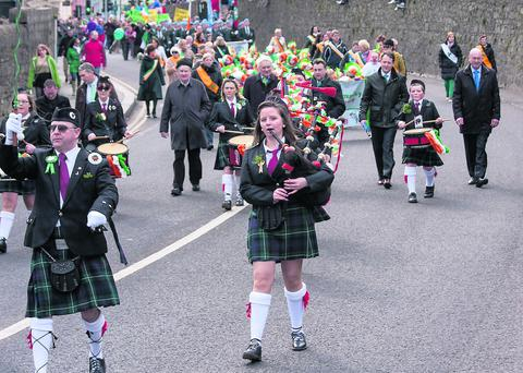The Thomas Kent Pipe Band from Fermoy heads down the hill in the St Patrick's Day parade, closely followed by Fermoy councillors. Photo: Dermot FitzGerald