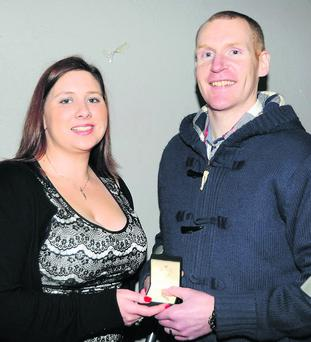 Aisling Carroll presenting All-Ireland Junior Club runner-up medal to Dessie Fitzgerald.