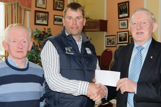 Gordon Kingston, ABS, presenting a sponsorship cheque to Tim Broderick of Charleville Show with Willie Mulcahy (Show).
