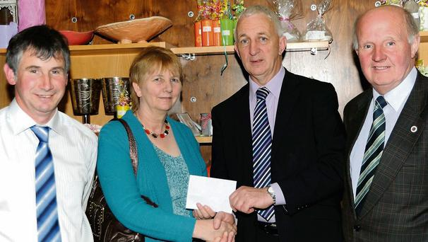 Eleanor Fitzsimons presenting a sponsorship cheque to Conor Counihan, CEO St. Joseph's Foundation for their greyhound benefit night with Eamon McCarthy, chairman board of directors (left) and Tony Fitzsimons.