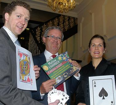 President of Mallow Chamber Kevin O'Keeffe, Darren Owens of the Hibernian Hotel Mallow and Noreen Welch manger of Mallow branch of AIB launching the Mallow Chamber casino night which is to be held in the Hibernian Hotel Mallow on March 9.