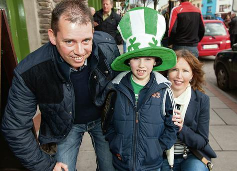 Danny (8) with dad Stephen and Sammy McKirgan enjoying the Macroom St Patrick's Day Parade. Picture: John Delea.