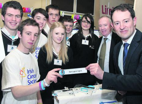 The 'Don't Light It Fight It' mini company, Nagle Rice Secondary School, Doneraile, overall winners of the North Cork Schools Enterprise Programme 2013 Regional Finals in the Charleville Park Hotel pictured with Minister of State, Sean Sherlock who presented the awards. Included is Michael Hanley, CEO, North Cork Enterprise Board. Photo: Patrick Casey