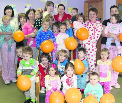 Babies, Toddlers, and Pre-school children celebrating National Pyjama Day with Manager Margaret Kerins and staff, at Tír na nÓg Creche, Ballydesmond. Photo by Sheila Fitzgerald.