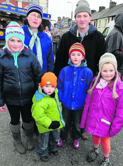 Well buttoned up for the Millstreet Horse Fair were Brendan and Clare O'Connell along with children Eilís Dylan, Kieran and Grainne from Macroom. Photo: John Tarrant