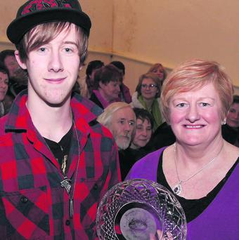 Dara Meehan, Scoil Mhuire, Kanturk, winner of the Schools Poetry competition at the 2013 Kanturk Arts Festival receives his prize from competition organiser, Margaret Cotter. Photo: Patrick Casey