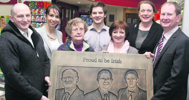 Jermiah Dennehy, far left, makes a special presentation some years ago to Michael Twohig and from left, Eileen Linehan, Eilish Twohig, Michael Twohig Jr, Noreen Twohig and Maura Walsh. Photo: Patrick Casey