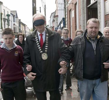 Mayor Noel O'Connor is guided through Mallow by Davis College pupil Tony Kavanagh and Richard Napier of the Gilbert Centre. Photo: Bernadette Hayes