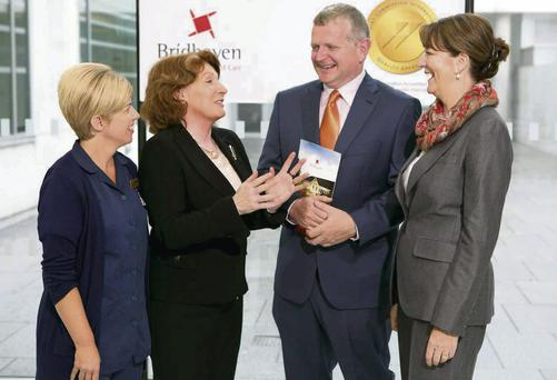Paul Rochford, Registered Provider at Brídhaven (centre), with Minister of State Kathleen Lynch TD and Donna McNamara, Person in Charge (left), and Helen Morley, HR Manager, right.
