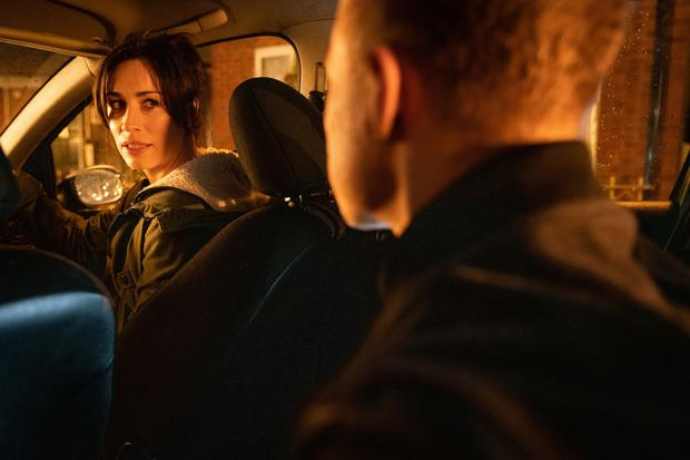 Clayton gets into the back of the car and orders Shona to follow his instructions and drive in Coronation Street