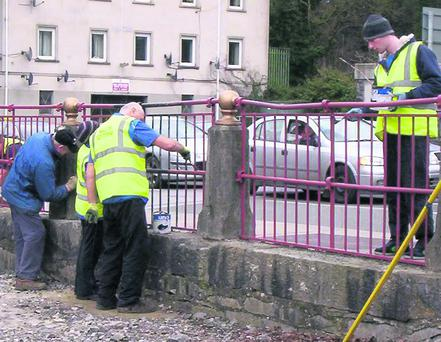 Men At Work. Mallow Tidy Town workers working at Mallow Bridge last Saturday.