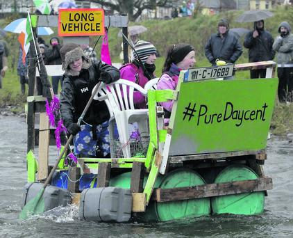 Dubliners Tes Coyne, Tim Coyne and Ria O'Hanlon on their raft 'Pure Daycent'. Picture: Clare Keogh