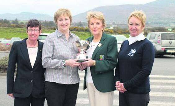 Nora O'Connor receiving her Munster Junior Championship trophy last weekend at Dooks Golf Club. Also pictured are Mallow lady captain Deirdre Lenehan and Lady Captain Helen O'Boyle.