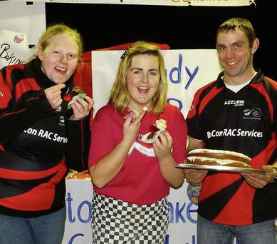 Mitchelstown Macra members Tara Whelan, Mairead Allen and William Keane getting ready for the big bake-off.