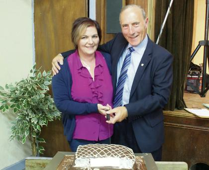 Former Rylane school principal Con Lynch cuts the cake presented to him at the 'This is your Life' event at Rylane Community Centre last weekend.
