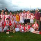 the Banteer U 13 hurling team celebrating their victory over Millstreet recently in the Rebel og north region final which was played in Kanturk