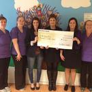 The staff of Banteer Childcare present a cheque for €4,500 to the CUH breast cancer unit
