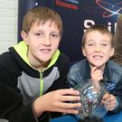 Brothers Patrick and Cian Segondat getting a buzz at the SciFest Stand during Mallow Science Fair