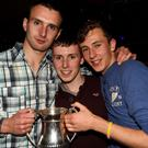 Dan O'Connor, Daire Murphy and Kevin O'Connell, members of Sliabh Luacra Gaels that won the Minor 'A' League were celebrating at the bank holiday weekend disco at Safaris Nightclub Newmarket
