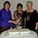 Deirdre Hickey, Cork Federation President, Kathie O'Neill, Guild President and Marie O'Toole, National President cutting the celebratory cake at the Inniscarra-Ballincollig ICA Guild 80th Anniversary Dinner at Oriel Hotel. Picture: Mike English
