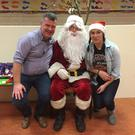 Tim Ring and Tricia Twohig meet Santa at the recent Kilshannig GAA Children's Christmas Party