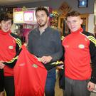Ronan Cooney of Cooney's Quik Pick presented the Coachford College Senior Teams with sports tops. Accepting the tops on behalf of the team are players, Niall Barry Murphy and Matthew O'Brien Bradley