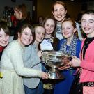 Cork dual star Rena Buckley displayed the O'Duffy Cup to young Millstreet Camogie players Molly Morley, Fia Hurley, Orla O'Leary, Cathy Byrnes, Beibhinn Moynihan and Carolyn Buckley at the Millstreet Camogie function, Picture John Tarrant