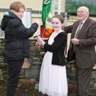 Katelynn Cremin and Ian McSweeney raising the Flag at the Lombardstown 1916 Commemoration with local Historian Donie O'Sullivan