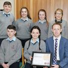 Kerry football star Colm Cooper dropped in to Boherbue Comprehensive School to present Certificates to students who were Regional Finalists in the AIB and First Trust Bank Build a Bank Challenge 2015-16. Also included are Peter Doyle of AIB Kanturk, Mary O' Keeffe, Boherbue Comprehensive Principal, DJ McSweeney, Vice Principal, and the Build a Bank Team of John Walsh, Assistant Manager, Áine Breen, Manager, Sean Meehan, Financial Controller, Róisín Murphy, Sales & Marketing, Aoife Kerins, Customer Service, and Matt Murphy, Digital Officer. Photo by Sheila Fitzgerald
