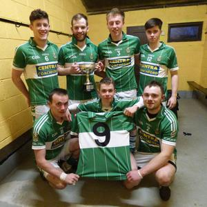 Aghabullogue Under-21 footballers with the retired jersey of former team mate, the late Greg Long