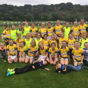 Kilshannig Ladies U12s with various mascots, celebrating the end of the Munster Ladies Football blitz recently
