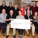 Members of Duhallow Vintage Club who presented at cheque for €1,775 to Linda Grogan (centre front) Nurse Manager at Mallow Alzheimers Day Centre. The money was the proceeds of Ted Collin's Memorial Run from Dromtarriffe to Ballyhea recently