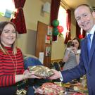 Fianna Fáil Leader Micheál Martin doing his Christmas shopping at Boherbue Christmas Market where he bought some of Danielle Cashman's delicious home baking