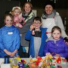 Cillian Barrett, Lisgriffin, Alison and Emma Kerrisk, Mallow, Shannon Fitzgerald, Ballydesmond, and Abbie Cronin, Kiskeam, having fun with Esther O'Sullivan of Messy Hands, Kanturk, during the Christmas Market at the Donkey Sanctuary in Liscarroll