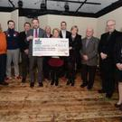 Eileen Murphy presenting a cheque for over €18,700 to Micheál Sheridan, CEO of the Mercy Hospital Foundation, included also are Patrick Buckley, Eamon Tarrant, Kevin Roche, Denis Withers, Donie Barry, Dr John Dowling, Elaine Hanna, Tommy Mannix, Fr William Winter PP, Ester O'Riordan, Dr Jemma Brown