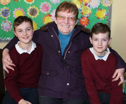 Graeme Kennedy and Conor Foley celebrating grand parents day at Freemount National School with their Nan Eucheria Foley