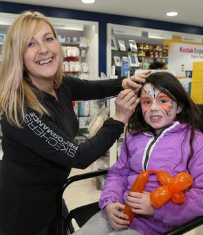 Meabh Casey having her face painted by Selena from Children's Entertainment Ireland during Opening Day at Reen's Pharmacy in Millstreet